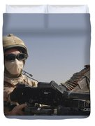 A British Army Soldier Mans A Machine Duvet Cover by Andrew Chittock