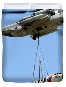 A Ch-53 Sea Stallion Lifts A Hu-25 Duvet Cover by Stocktrek Images