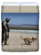 A Dog Handler Conducts Improvised Duvet Cover by Stocktrek Images