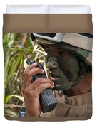 A Malaysian Paratrooper Maintains Duvet Cover by Stocktrek Images