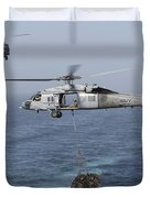 A Mh-60s Knighthawk Transfers Cargo Duvet Cover by Gert Kromhout