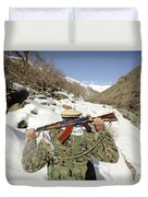 A Mujahadeen Guard Walks With U.s Duvet Cover by Stocktrek Images