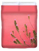 A Pink Flowering Plant Growing Beside A Duvet Cover by Stuart Westmorland