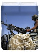 A Soldier Of The British Army Mans Duvet Cover by Andrew Chittock