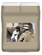 A Soldier Talks To A Local Villager Duvet Cover by Stocktrek Images