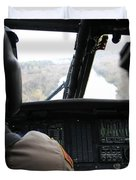 A Uh-60 Blackhawk Flies The River To An Duvet Cover by Terry Moore