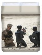 An Afghan Police Student Prepares Duvet Cover by Terry Moore