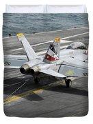An Fa-18f Super Hornet Traps An Duvet Cover by Stocktrek Images
