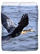 Anhinga In Flight Duvet Cover by Roger Wedegis