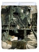 Camouflage Netting Covers A Cargo Truck Duvet Cover by Stocktrek Images