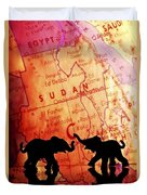 Elephant Silhouettes In Front Of A Map Duvet Cover by Chris Knorr