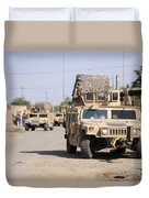 Humvees Conduct Security Duvet Cover by Stocktrek Images