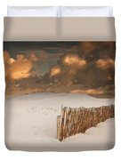 Illuminated Clouds Glowing Over A Snow Duvet Cover by John Short