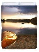 Lake sunset with canoe on beach Duvet Cover by Elena Elisseeva