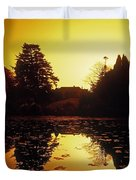 Silhouetted Home And Trees Near Water Duvet Cover by The Irish Image Collection