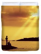 Silhouettes on the Beach Duvet Cover by Carlos Caetano