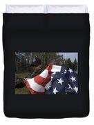 Soldier Unfurls A New Flag For Posting Duvet Cover by Stocktrek Images