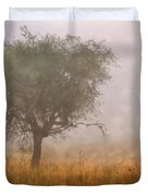 Tree In Fog Duvet Cover by Debra and Dave Vanderlaan