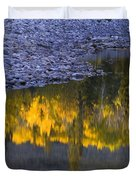 Water Reflections With A Rocky Shoreline Duvet Cover by Carson Ganci