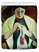 Woman Sewing Duvet Cover by August Macke