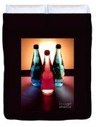 Electric Light Through Bottles Duvet Cover by Caroline Peacock