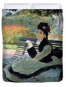 Madame Monet On A Garden Bench Duvet Cover by Claude Monet