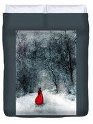 Woman In Red Cape Walking In Snowy Woods Duvet Cover by Jill Battaglia