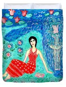 Woman Reading Beside Fountain Duvet Cover by Sushila Burgess