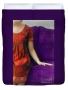 Young Woman In Red On Purple Couch Duvet Cover by Jill Battaglia