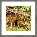 Jungle Hut In A Tropical Rainforest Framed Print by Colin Utz