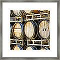 Rack Of Old Oak Wine Barrels Framed Print by Susan  Schmitz