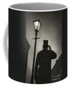 Victorian Man With Top Hat Under A Gas Lamp Coffee Mug by Lee Avison