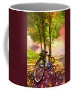 Bicycle Under The Tree Coffee Mug by Debra and Dave Vanderlaan