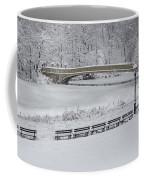 Bow Bridge Central Park Winter Wonderland Coffee Mug by Susan Candelario