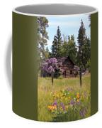 Cabin And Wildflowers Coffee Mug by Athena Mckinzie