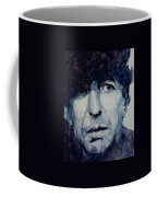 Famous Blue Raincoat Coffee Mug by Paul Lovering