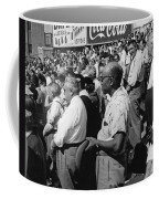 Fans At Yankee Stadium Stand For The National Anthem At The Star Coffee Mug by Underwood Archives