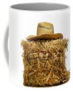 Farmer Hat On Hay Bale Coffee Mug by Olivier Le Queinec