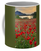 Field Of Poppies At The Lake Coffee Mug by Guido Montanes Castillo
