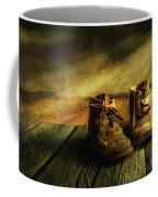 First Shoes Coffee Mug by Veikko Suikkanen