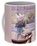 Flowers And Book On Table Coffee Mug by Julia Rowntree