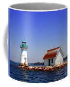 Lighthouse On The St Lawrence River Coffee Mug by Olivier Le Queinec