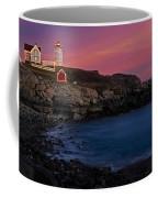 Nubble Lighthouse At Sunset Coffee Mug by Susan Candelario