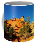 Orange Foreground A Blue Blue Sky  Coffee Mug by Jeff Swan
