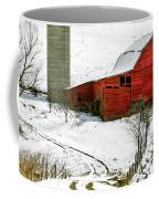 Red Barn In Snow Coffee Mug by John Haldane