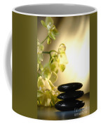 Stone Cairn And Orchids Coffee Mug by Olivier Le Queinec