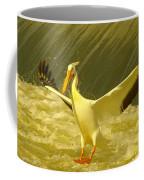 The Pelican Lands Coffee Mug by Jeff Swan