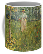 Woman In A Garden Coffee Mug by Vincent van Gogh