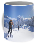 Cross-country Skiers In The Selkirk Coffee Mug by Jimmy Chin