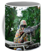 A Belgian Army Soldier Handling Coffee Mug by Luc De Jaeger